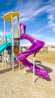 Vertical frame Colorful blue and purple slides in kids playground