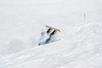 Snowboarder fall down with snow splashes