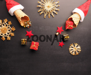 Ice cream cones with hat of Santa and gift boxes