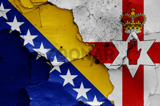 flags of Bosnia and Herzegovina and Northern Ireland painted on cracked wall
