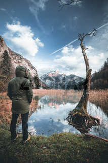 Relaxed hiker enjoys stunning view on mountain and lake in austria