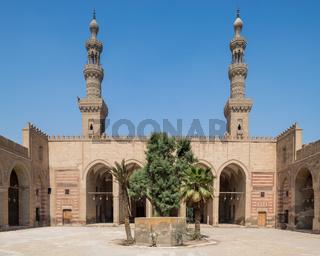 Courtyard of al Nasir Faraj ibn Barquq public historical mosque with two minarets, Cairo, Egypt