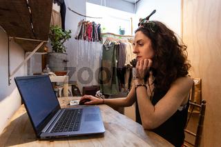 Fashion designer is sitting at office