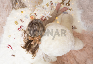 Female holds a snowflake Christmas ornament for the tree
