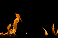 Fire flame on black background. Blaze fire flame textured background.