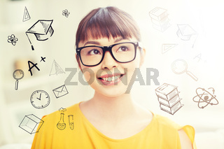 happy asian young woman in glasses at home