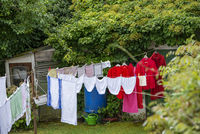 Laundry is hanging in a garden