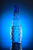 Clean and Pure Mineral Drinking Water in a Blue Bottle
