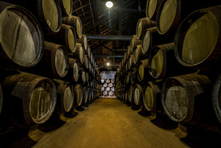 PORTO, PORTUGAL - June 19, 2018: Port wine barrels in Graham's port lodge, Vila Nova de Gaia, Porto, Portugal