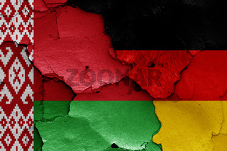 flags of Belarus and Germany painted on cracked wall