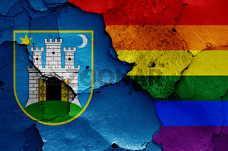 flags of Zagreb and LGBT painted on cracked wall