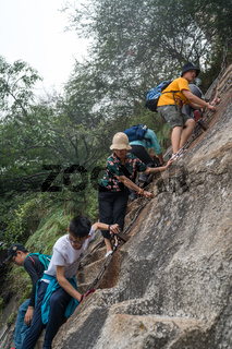 Climbers tackling steep stone stairs on Huashan mountain