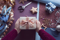 Hands holding present for Christmas