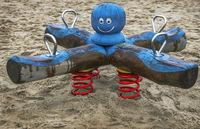 Children's swing at the Baltic Sea beach of Schleswig-Holstein