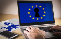Laptop with eu flag and keyhole on screen