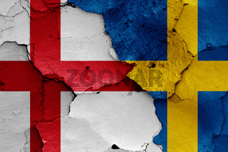 flags of England and Sweden painted on cracked wall