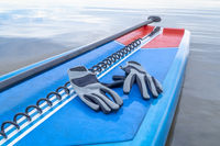 Paddling gloves, safety leash and SUP paddle