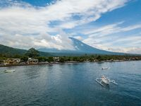 Aerial view of Amed Beach and Mount Agung volcano in Bali