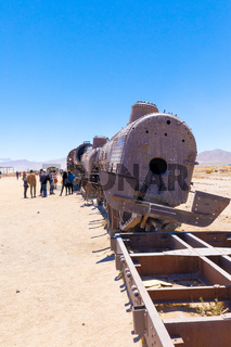 Bolivia Uyuni tourists take photos of the train cemetery