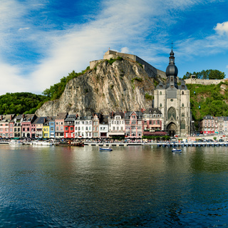 view of the small town of Dinant with Maas river and citadel and cathedral in the old town