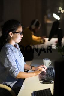 Latin-American Woman Working at Night