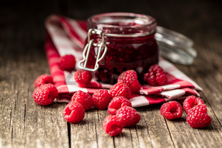 Sweet raspberry jam and raspberries.