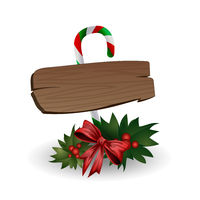 Festive composition of wooden boards decorated with bows, Christmas tree branches and candy on a white background