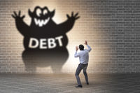 Businessman in debt and loan concept