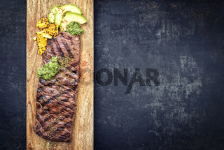 Barbecue dry aged wagyu flank steak with corn