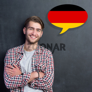 Man learn speaking german in bubble on chalkboard
