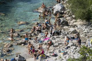 Sunbatghing on the Isonzo river in Kobarid.