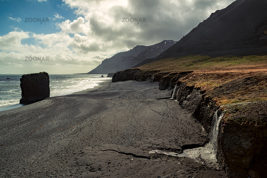 Small waterfall in a black beach, Iceland