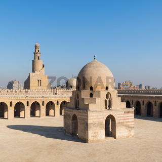 Courtyard of Ibn Tulun public historical mosque with ablution fountain and the minaret, Cairo, Egypt