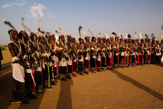 Men dancing Yaake dance and sing at Guerewol festival in InGall village, Agadez, Niger