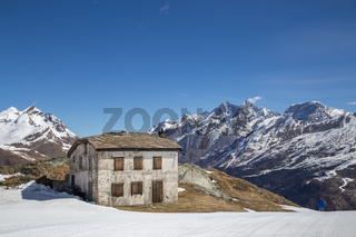 Stone Hut in the snowy Swiss Moutains