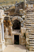 Side entrance to the stage of the amphitheater. Ancient antique amphitheater in city of Hierapolis in Turkey.