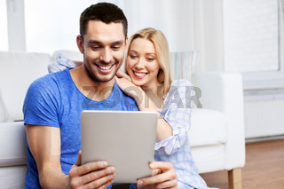 happy couple with computer at home