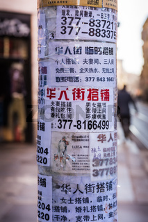 Chinese Letters on Random Papers Taped to Pole in Milan Italy Chinatown Winter 2016
