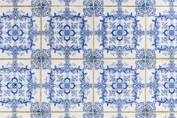 Nazare, Portugal - July 17, 2019: Weathered typical Portuguese blue tiles, aka azulejos