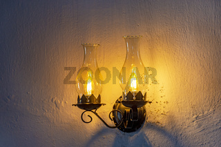 Two old lamps adapted for electric light