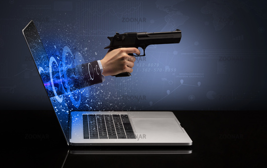 Hand with gun coming out of a laptop