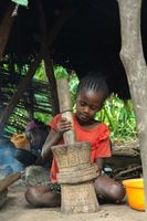 Ethiopian girl pounding grains