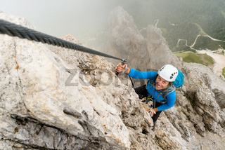 young attractive female mountain climber in the Dolomites of Italy