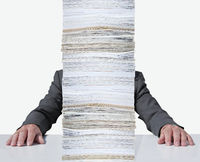 Person behind a paper stack