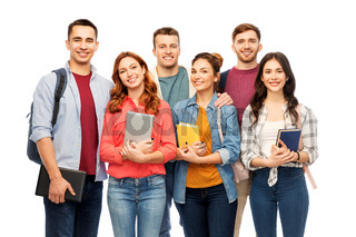 group of smiling students with books