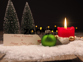 Christmas greetings with a vintage bauble and candle light