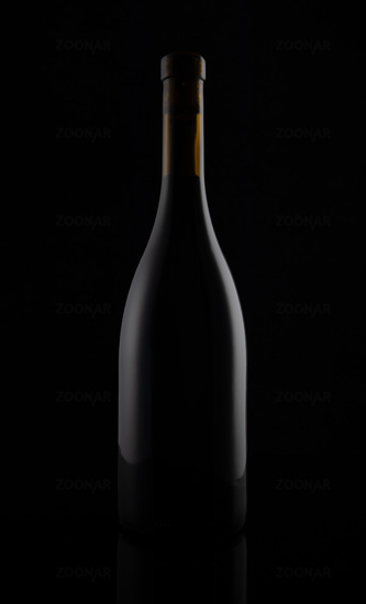 Isolated black matt wine bottle on dark background