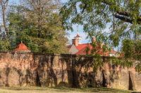 Roofs of Mount Vernon behind walled garden in Virginia
