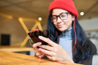 Trendy  Young Woman Holding Smartphone