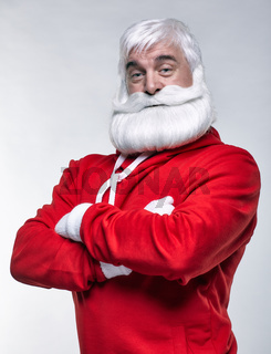 Portrait of a Santa Claus in sportsware with hands crossed